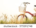 vintage of bicycle on grass... | Shutterstock . vector #575391748