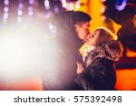 young couple in love outdoor... | Shutterstock . vector #575392498