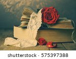 Red Rose On An Old Book In A...