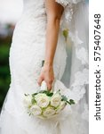 bride holds hand with wedding... | Shutterstock . vector #575407648