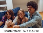 a couple of friends having fun... | Shutterstock . vector #575416840