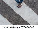 young woman feet  crossing an... | Shutterstock . vector #575434063