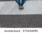 young woman feet  crossing an...   Shutterstock . vector #575434090