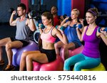friends holding dumbbells while ... | Shutterstock . vector #575440816