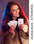 beautiful brunette holding four ... | Shutterstock . vector #575440903