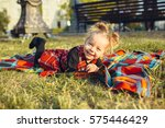 smiling girl on the meadow... | Shutterstock . vector #575446429