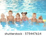 little kids in swimming pool on ... | Shutterstock . vector #575447614