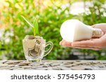 woman hand is holding led bulb...   Shutterstock . vector #575454793