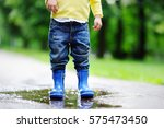 toddler jumping in pool of... | Shutterstock . vector #575473450