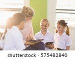 teacher teaching kids on... | Shutterstock . vector #575482840