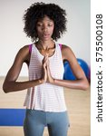 woman performing yoga in gym | Shutterstock . vector #575500108