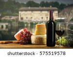 red wine in vintage light with... | Shutterstock . vector #575519578
