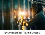 worker cutting steel sheet by... | Shutterstock . vector #575529058