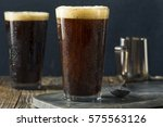 frothy nitro cold brew coffee... | Shutterstock . vector #575563126