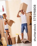 happy couple moving in new... | Shutterstock . vector #575598808
