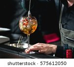 bartender making refreshing... | Shutterstock . vector #575612050