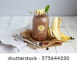 banana chocolate smoothie with... | Shutterstock . vector #575644330