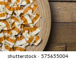 pasta bows on a wooden plater... | Shutterstock . vector #575655004