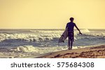Surfer On The Beach. Morning O...
