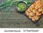 shrimps fried with sauce on the ... | Shutterstock . vector #575695069