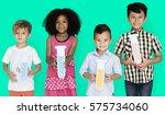 little children holding test... | Shutterstock . vector #575734060