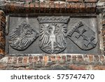 Small photo of The old polish royal emblem, the emblem of the city Gdansk, Danzig. Stone.
