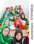 Small photo of Afghanistan - circa October 2011: Young native girls wear colourful hijabs and pose at ADRA school opening in Afghanistan. Documentary editorial.