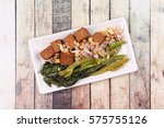fried kale with tofu in brown... | Shutterstock . vector #575755126