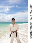 young man practicing karate at... | Shutterstock . vector #575757289