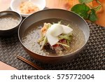 naengmyeon  chilled buckwheat... | Shutterstock . vector #575772004