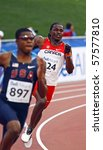 Small photo of MONCTON, CANADA - JULY 20: Alistair Moona of Canada (224) and Errol Nolan of USA (897) run in the men's 400 metres at the 2010 IAAF World Junior Championships July 20, 2010 in Moncton, Canada.