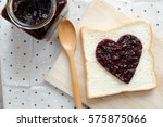 toast with jam in shape of... | Shutterstock . vector #575875066