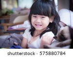 little asian girl smiling | Shutterstock . vector #575880784
