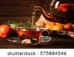 pouring tangerine tea into cup... | Shutterstock . vector #575884546