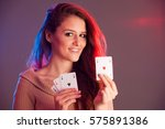 beautiful brunette holding four ... | Shutterstock . vector #575891386