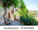 old street of gordes  a small... | Shutterstock . vector #575905384