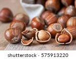 hazelnut heap on wooden table ... | Shutterstock . vector #575913220