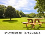 Picnic Table On A Green Meadow...