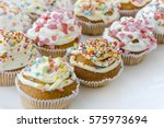 colorful cupcakes with white... | Shutterstock . vector #575973694