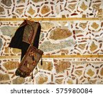 old stone wall and saddlebag | Shutterstock . vector #575980084