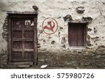 Small photo of Communist symbol on a house in Nepal. Hammer and sickle