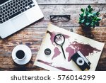 world map with laptop on wooden ... | Shutterstock . vector #576014299