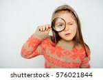 little girl with a magnifying... | Shutterstock . vector #576021844