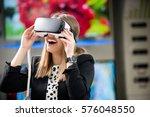 young woman wearing virtual... | Shutterstock . vector #576048550