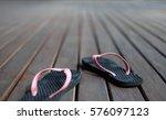Pair Of Black And Pink Sandal...