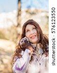 menopausal woman in ski suit... | Shutterstock . vector #576123550
