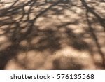 shadow of tree on ground | Shutterstock . vector #576135568