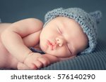 sleeping newborn baby on a... | Shutterstock . vector #576140290