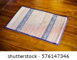staw mat plate on wood table. | Shutterstock . vector #576147346