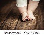 baby feet doing the first steps.... | Shutterstock . vector #576149458